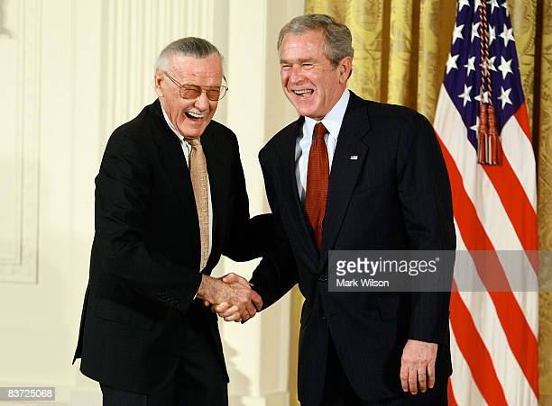 S President George W Bush congratulates Stan Lee founder of POW Entertainment before presenting him with the 2008 National Medals of Arts award...