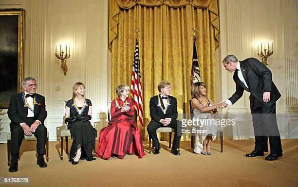 President George W Bush congratulates Tina Turner during a reception for the Kennedy Center Honors in the East Room of the White House Sunday Dec 4...