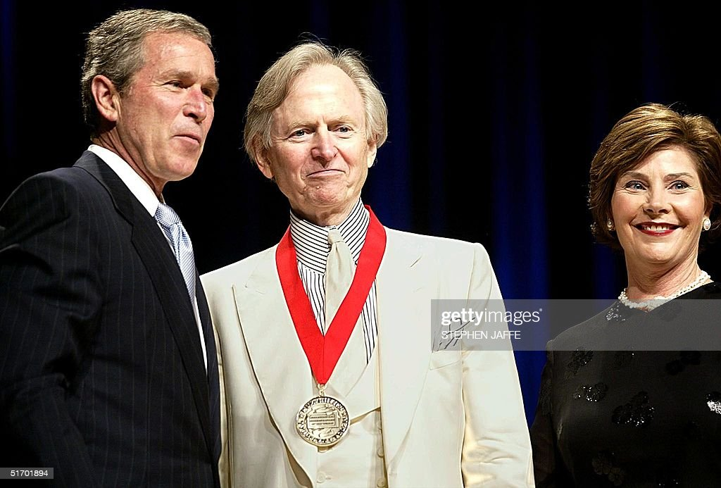 US President George W. Bush (L) congratulates writer Tom Wolfe (C) along with First Lady Laura Bush 22 April 2002 at DAR Constitution Hall in Washington. Wolfe was awarded the National Humanities Medal by the National Endowment of the Arts. AFP Photo/Stephen JAFFE