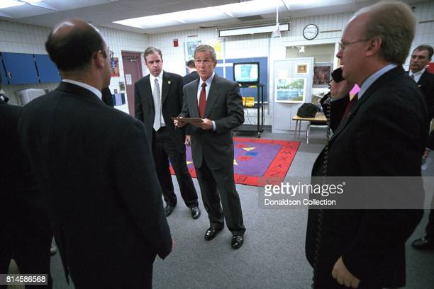 President George W Bush consults with senior staff Tuesday Sept 11 at Emma E Booker Elementary School in Sarasota Fla Senior staff include from left...