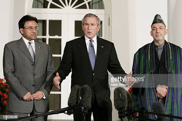 President George W. Bush deliver remarks while flanked by Afghanistan President Hamid Karzai and Pakistani President Pervez Musharraf in the Rose...