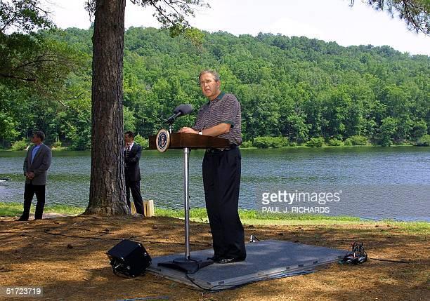 President George W. Bush delivers a speech on enviromental stewardship next to a lake at Oak Mountain State Park near Birmingham, Alabama, before...