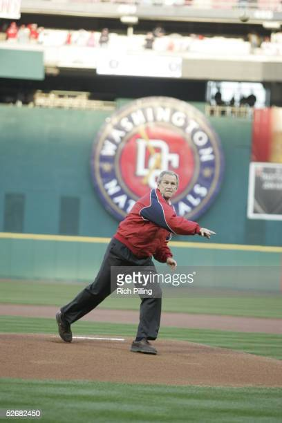 President George W Bush delivers the ceremonial first pitch during the pregame ceremonies before the Nationals 2005 home opener at RFK Stadium on...