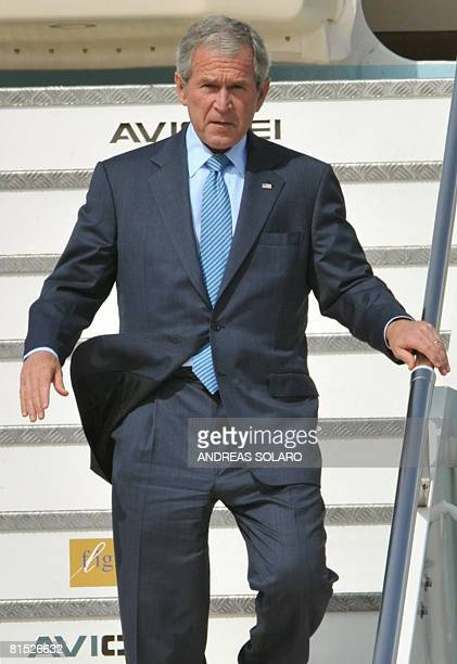US President George W Bush disembarks from Air Force One at Ciampino airport in Rome on June 11 2008 On the third leg of his farewell European tour...