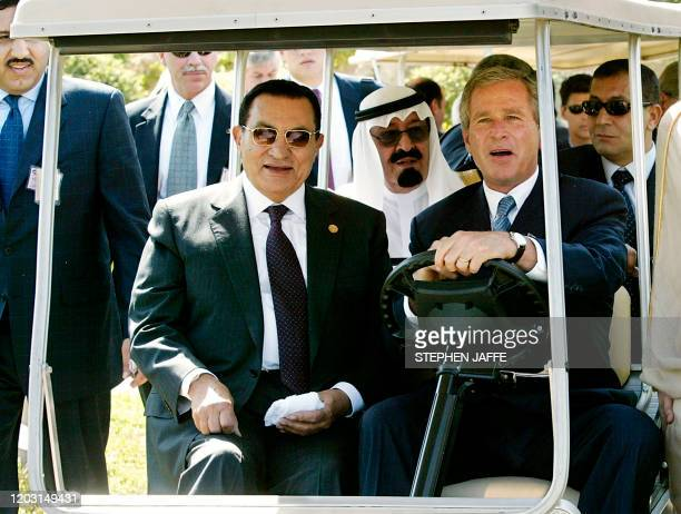 President George W. Bush drives a golf cart to the event site with Egyptian President Hosni Mubarak and Saudi Crown Prince Abdullah at the Four...