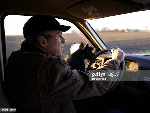 US President George W Bush drives to his daily intelligence briefing inside a secure trailer on the Bush Ranch in Crawford Texas