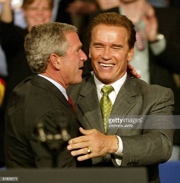 President George W. Bush embraces California's Governor Arnold Schwarzenegger at a campaign rally at Nationwide Arena 29 October 2004 in Columbus,...