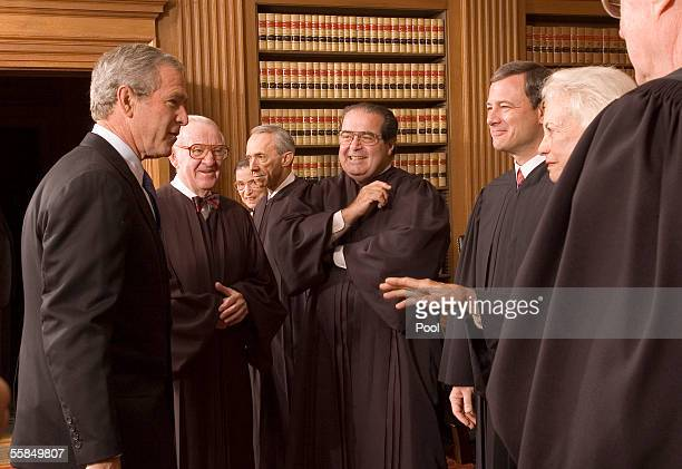 S President George W Bush enjoys a light moment with Supreme Court Justices John Paul Stevens Ruth Bader Ginsburg David H Souter Antonin Scalia Chief...