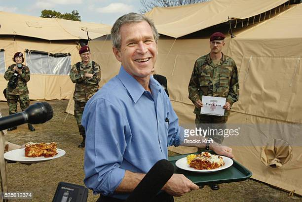 President George W Bush enjoys a military meal while visiting Fort Bragg President Bush was in North Carolina to recognize those who had been serving...