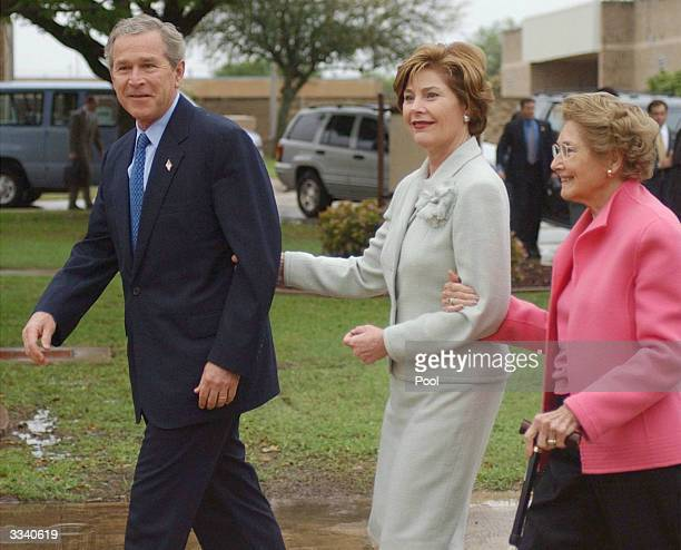 President George W Bush first lady Laura Bush and her mother Jenna Welch leave an Easter service April 11 2004 in Ft Hood Texas