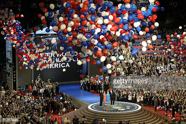 S President George W Bush First Lady Laura Bush Lynne Cheney and Vice President Dick Cheney wave to the crowd as balloons fall from the ceiling on...