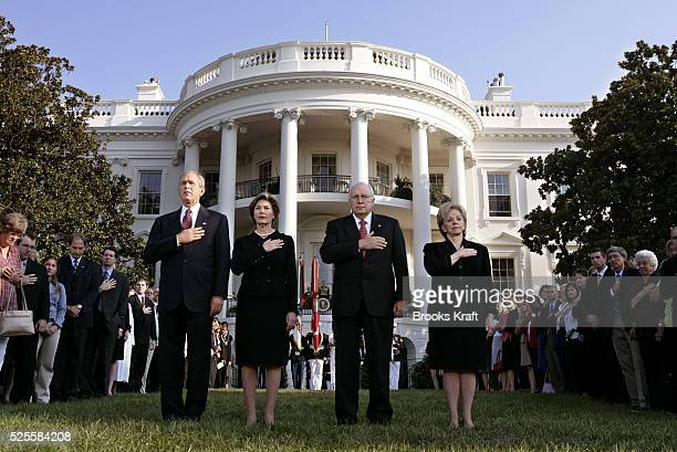 US President George W Bush First Lady Laura Bush Vice President Dick Cheney and his wife Lynne Cheney participate in a moment of silence on the south...