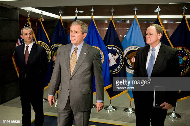 President George W. Bush flanked by National Counterterrorism Director Mike Leiter and National Intelligence Director Mike McConnell, speaks at the...