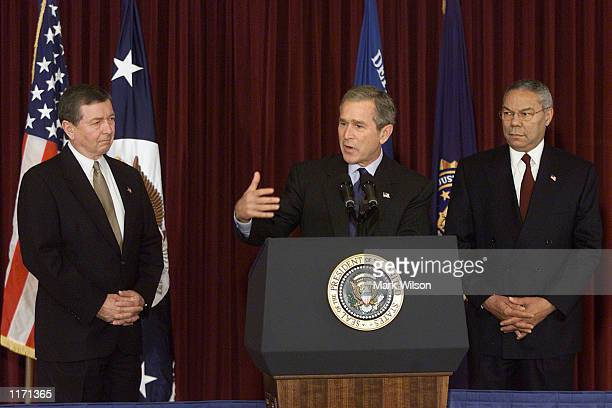 S President George W Bush flanked by Secretary of State Colin Powell and Attorney Genaral John Ashcroft announce's a new list for the FBI's Most...