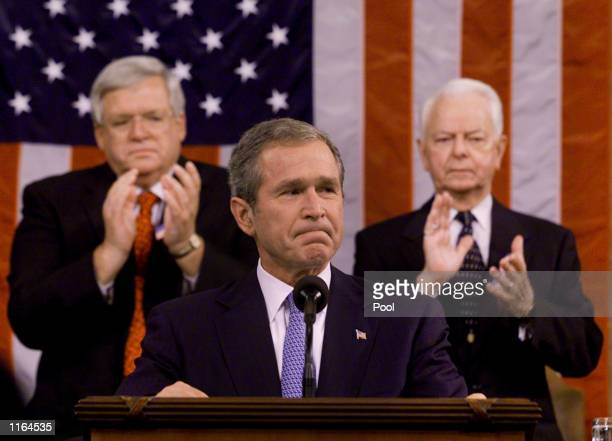 S President George W Bush flanked by Speaker of the House Dennis Hastert and Sen Robert Byrd gets applause during a joint session of Congress at the...