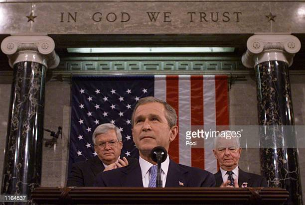 President George W. Bush, flanked by Speaker of the House Dennis Hastert and Sen. Robert Byrd , gets applause during a joint session of Congress at...