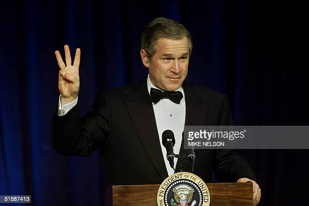 President George W Bush flashes the 'W' sign for his middle name 'Walker' as he greets supporters at the Marriott Wardman Inaugural Ball in...