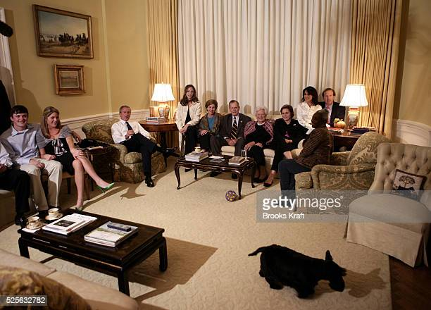 US President George W Bush gathers with members of his family in the West Sitting Hall of the White House residence as they watch 2004 presidential...