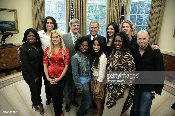 US President George W Bush gathers with the top nine American Idol 2006 finalists in the Oval Office of the White House in Washington July 28 2006...