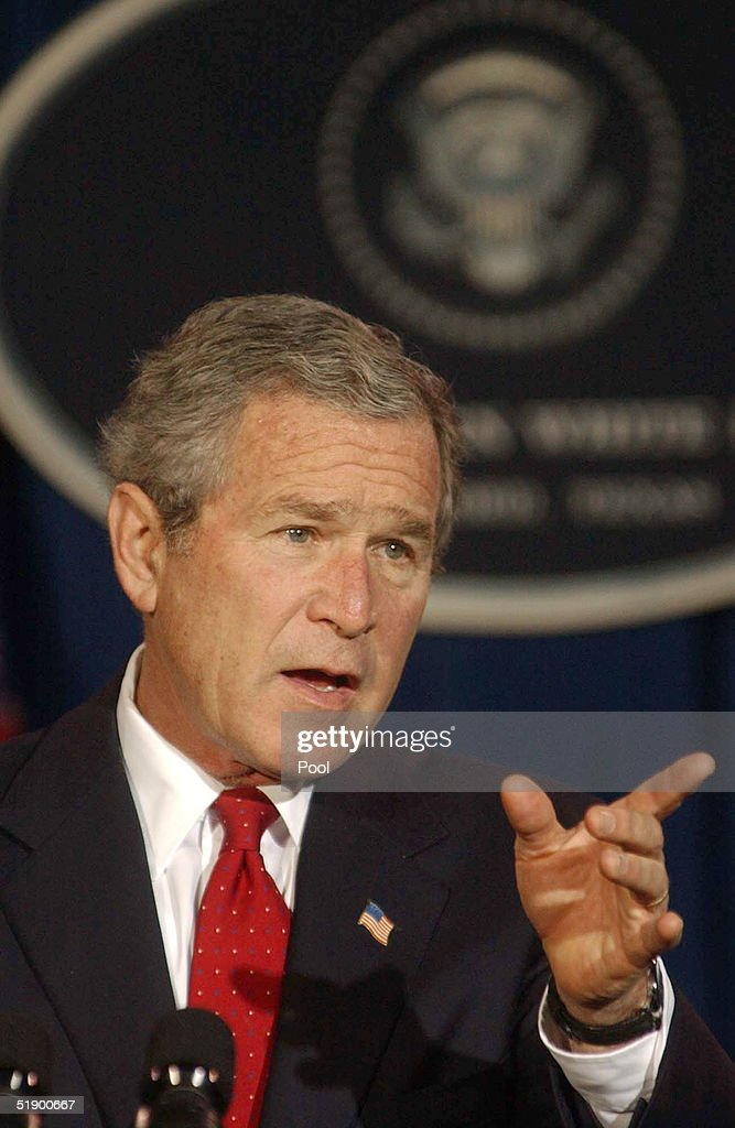 U.S. President George W. Bush gestures as he answers questions during a news conference at his ranch December 29, 2004 near Crawford, Texas. President Bush spoke on a large number of issues including the aid for the Tsunami victims, Iraq elections as well as flooding on the West Coast.