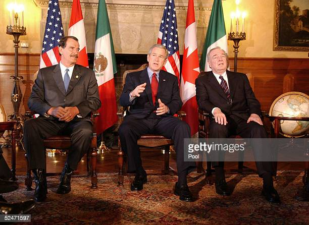 S President George W Bush gestures during a press conference with Mexican President Vicente Fox and Canadian Prime Minister Paul Martin March 23 2005...