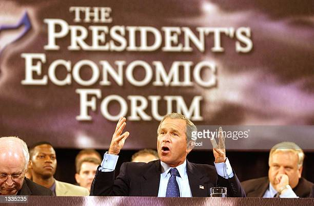 S President George W Bush gestures during his speech during The President's Economic Forum on August 13 2002 at Baylor University Law School in Waco...