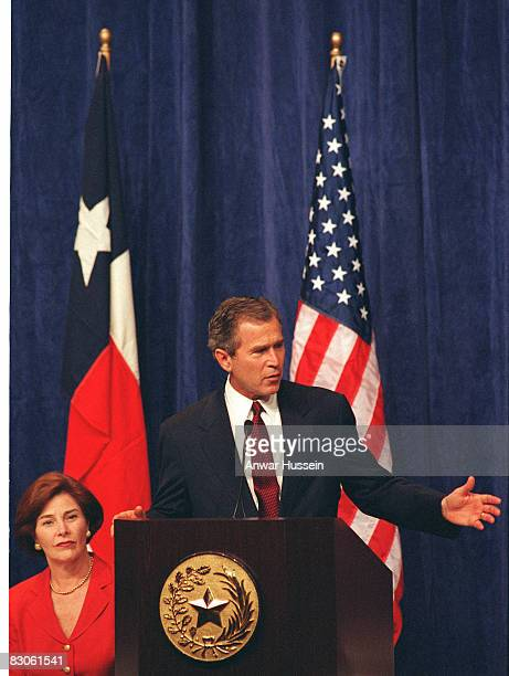 President George W Bush gives a speech while watched by his wife Laura Bush on June 16, 2003 in Dallas, Texas.