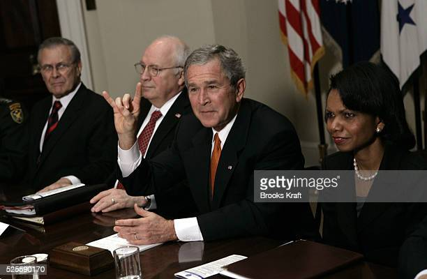 President George W Bush gives the sign for the college football team the Texas Longhorns, after a meeting about the war in Iraq with past and present...
