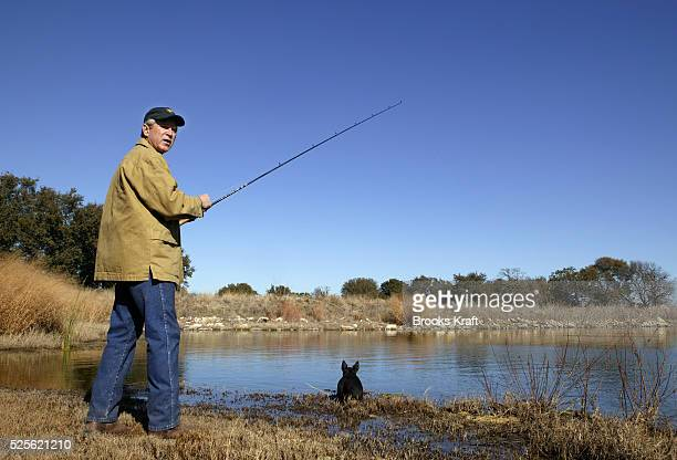 President George W Bush goes fishing with his dog Barney at the lake on the Bush ranch in Crawford Texas