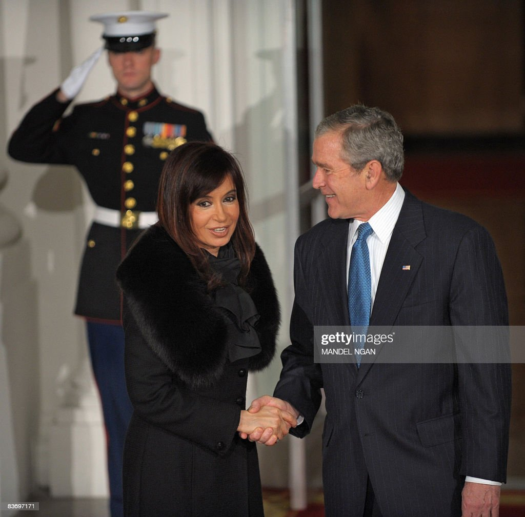 US President George W. Bush (R) greets A : News Photo