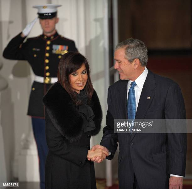 US President George W Bush greets Argentine President Cristina Kirchner on the North Portico of the White House in Washington DC prior to a dinner...