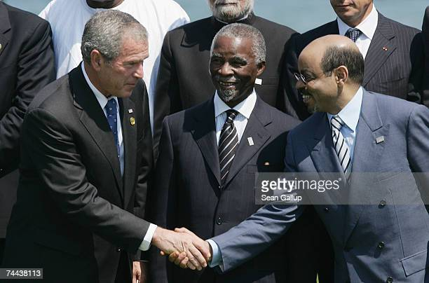 President George W. Bush greets Ethiopian Prime Minister Meles Zenawi as South African President Thabo Mbeki at a group photo opportunity at the...
