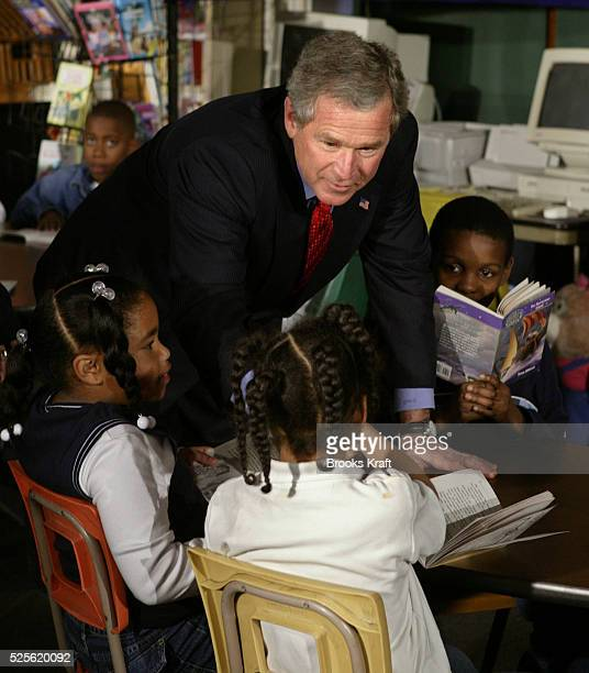 President George W Bush greets fourth graders at Pierre Laclede Elementary school in St Louis Missouri Bush paid a visit to the school to talk about...