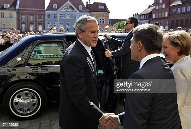 President George W Bush greets German Chancellor Angela Merkel's husband Joachim Sauer on July 13 2006 in Stralsund Germany Bush visits Merkel's...