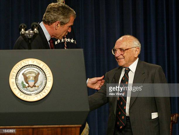 President George W. Bush greets Milton Friedman, recipient of the 1976 Nobel Prize for economic science, May 9, 2002 during a White House event in...