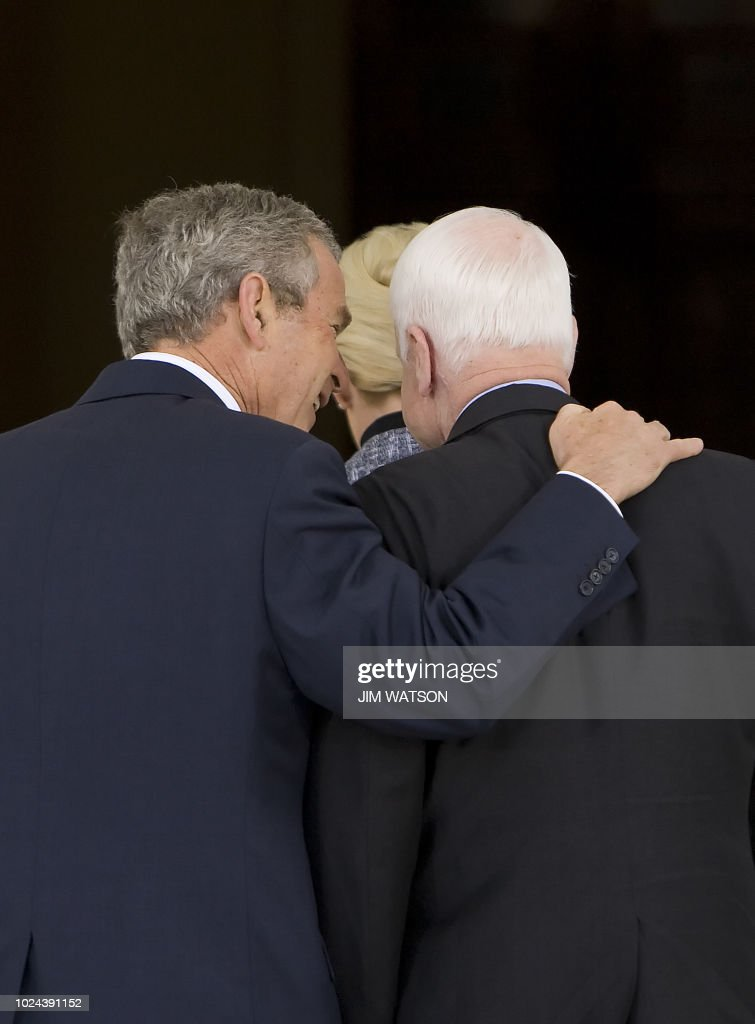 US President George W. Bush (L) greets Republican presidential candidate John McCain (R) to the White House in Washington, DC, on March 5, 2008. AFP PHOTO/Jim WATSON