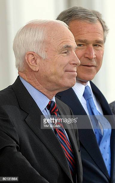 US President George W Bush greets Republican presidential candidate John McCain and at the North Portico of the White House on March 5 2008 in...