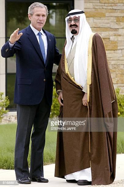 President George W Bush greets Saudi Arabia's Crown Prince Abdullah 25 April 2002 at his ranch in Crawford TX Bush and Crown Prince Abdullah are...