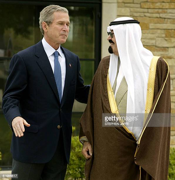 President George W Bush greets Saudi Arabia's Crown Prince Abdullah on his 1600 hundred acre ranch 25 April 2002 in Crawford Texas Bush and the Crown...