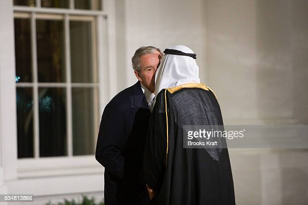 President George W Bush greets Saudi Arabia's King Abdullah bin Abdul Aziz Al Saud upon arrival at the North Portico of the White House before a...