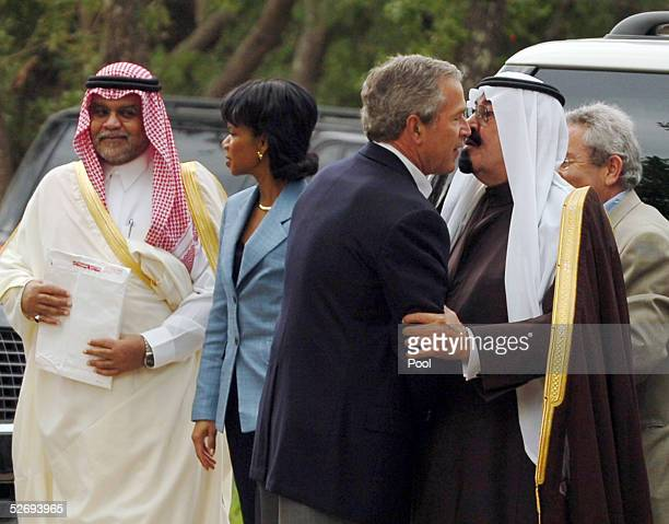 S President George W Bush greets Saudi Crown Prince Abdullah on his ranch April 25 2005 in Crawford Texas At left US Secretary of State Condoleezza...