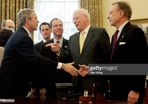 S President George W Bush greets Sen Arlen Specter Sen Patrick Leahy Rep Adam Schiff and Rep Anthony Weiner after a signing ceremony in the Oval...