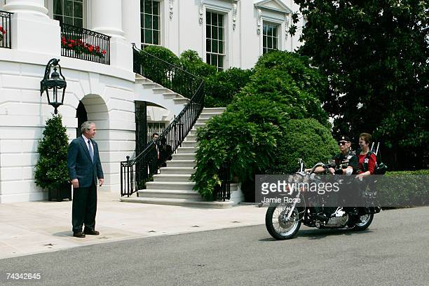 US President George W Bush greets Sergeant Arthur Artie Muller Founder and National Executive Director of Rolling Thunder and his wife Elaine Muller...