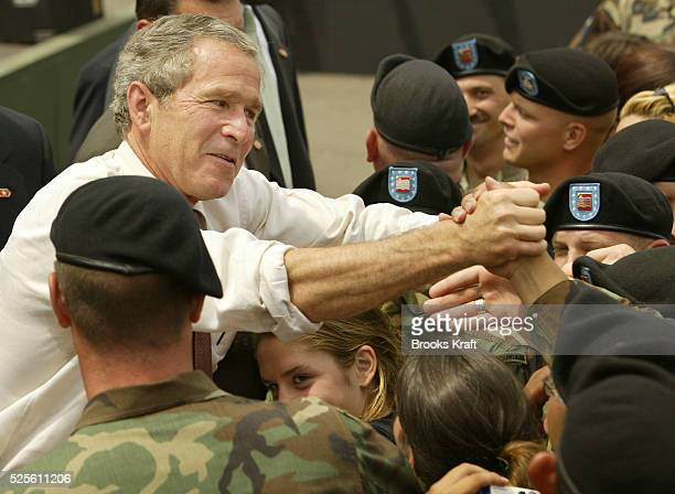 President George W Bush greets soldiers from the 10th Mountain Division at Fort Drum in New York The Division was the main fighting force on the...