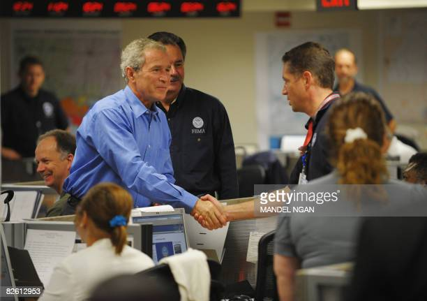 President George W. Bush greets workers while visiting the FEMA Operations Center following a briefing on hurricane Gustav August 31, 2008 at the...