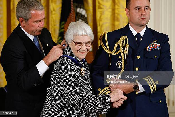 "President George W. Bush hangs a Presidential Medal of Freedom on the neck of Harper Lee , Pulitzer Prize winner and the author of ""To Kill A..."