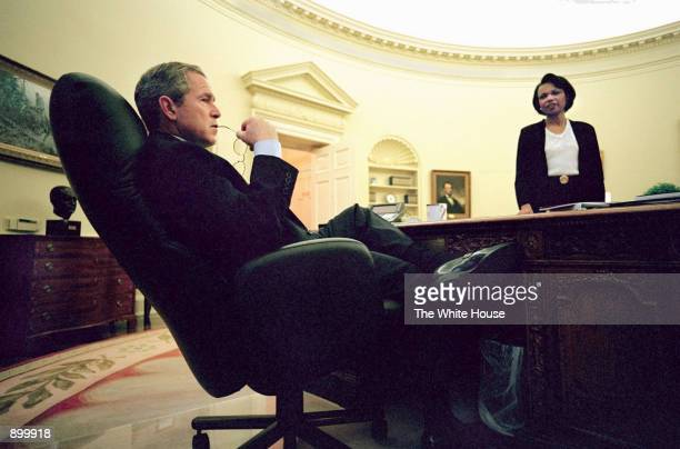 S President George W Bush holds a morning discussion about the latest developments in China with National Security Advisor Condoleezza Rice April 11...