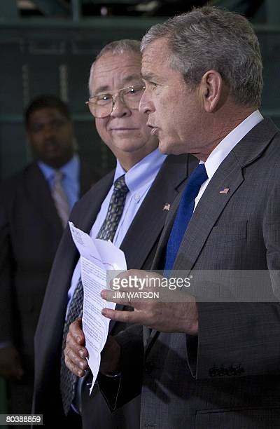 President George W. Bush holds an Internal Revenue Service mailer that was sent out to citizens explaining the benefits of the Economic Stimulus...
