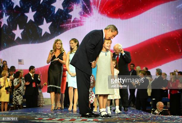 President George W Bush holds Vice President Dick Cheney's grandchild Kate Perry on the final night of the Republican National Convention September 2...