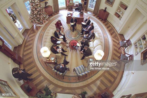 S President George W Bush hosts a meeting with members from the Office of Homeland Security and other White House staff December 20 2001 in the Oval...